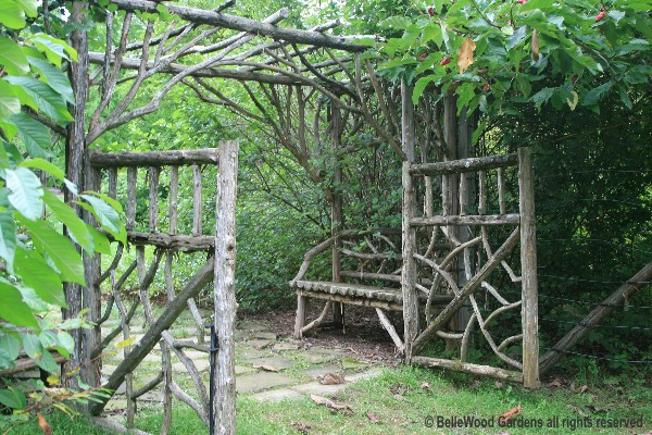 At Last   Through Another Rustic Garden Structure, Arbor And Gate Onto A  Lawn And Into The Fenced Acre/
